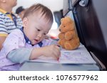 little asian 1 year old toddler ... | Shutterstock . vector #1076577962