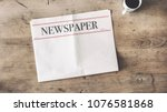 newspaper and coffee on wooden... | Shutterstock . vector #1076581868