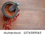chili peppers in stone mortar... | Shutterstock . vector #1076589065