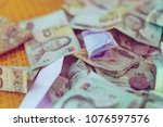 pile of banknote for background ... | Shutterstock . vector #1076597576