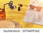 straw beach woman's hat and sun ... | Shutterstock . vector #1076609162