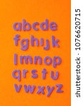 the alphabet in purple letters... | Shutterstock . vector #1076620715