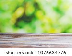 wooden table with blurred... | Shutterstock . vector #1076634776