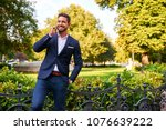 a handsome young businessman... | Shutterstock . vector #1076639222
