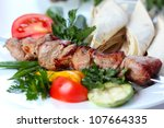 pork kebab with greens and... | Shutterstock . vector #107664335