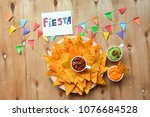 nachos chips with melted cheese ... | Shutterstock . vector #1076684528