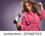 hair care.young woman using... | Shutterstock . vector #1076687315