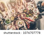 group of people clinking drinks | Shutterstock . vector #1076707778
