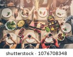 group of people having meal... | Shutterstock . vector #1076708348