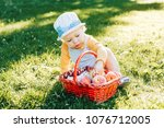 boy eating fruits peaches and... | Shutterstock . vector #1076712005