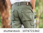 man wearing cargo pants... | Shutterstock . vector #1076721362