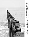 wooden wave breakers aligned on ... | Shutterstock . vector #1076728712