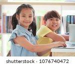 asian kids using laptop... | Shutterstock . vector #1076740472