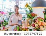 customer paying with credit... | Shutterstock . vector #1076747522