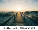 wooden walkway  beach and ocean ... | Shutterstock . vector #1076758508