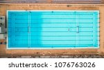 aerial top view of a swimming... | Shutterstock . vector #1076763026