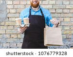 cropped shot of smiling male... | Shutterstock . vector #1076779328