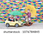 two funny caucasian children in ... | Shutterstock . vector #1076784845
