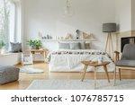 cozy hotel room interior with... | Shutterstock . vector #1076785715
