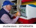 electrician fixing eletrical... | Shutterstock . vector #1076806856