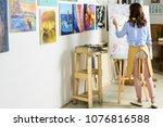 back view of left handed female ... | Shutterstock . vector #1076816588