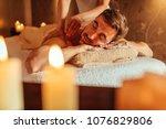 young man enjoying a massage at ... | Shutterstock . vector #1076829806