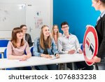 students listing to their... | Shutterstock . vector #1076833238