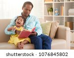 father reading a book for his... | Shutterstock . vector #1076845802