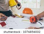 group asian engineer meeting ...   Shutterstock . vector #1076856032
