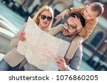 happy young family of tourists... | Shutterstock . vector #1076860205