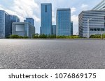 empty road with modern business ... | Shutterstock . vector #1076869175