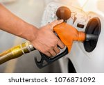car refueling on petrol station.... | Shutterstock . vector #1076871092