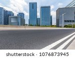 empty road with modern business ... | Shutterstock . vector #1076873945