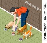 girl volunteer during feeding... | Shutterstock .eps vector #1076943902