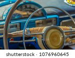 Driver's cockpit and the steering wheel of a vintage classic car. - stock photo