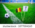Small photo of MOSCOW, RUSSIA - APRIL, 24, 2018: Belgium national flag and Official logo of Football FIFA World Cup 2018 in Russia.