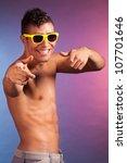 handsome man on studio with... | Shutterstock . vector #107701646