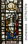Small photo of Clevedon, England - April 22, 2018: St Andrew's Church East Stained Glass Window Close up Saint Luke, Luke the Evangelist