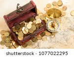 open treasure chest filled with ... | Shutterstock . vector #1077022295