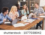 team of young programmers... | Shutterstock . vector #1077038042