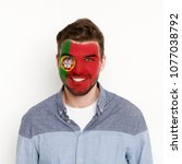 face of young happy man painted ... | Shutterstock . vector #1077038792