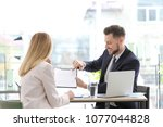 young consultant working with... | Shutterstock . vector #1077044828