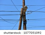 the post is electric with wires ... | Shutterstock . vector #1077051092