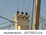 electric post with wires to the ... | Shutterstock . vector #1077051116