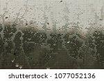 mosquito net with raindrops... | Shutterstock . vector #1077052136