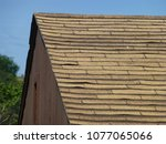 old damaged brown asphalt... | Shutterstock . vector #1077065066