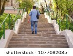 the man rising on steps up. | Shutterstock . vector #1077082085