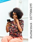 surprised african woman ... | Shutterstock . vector #1077086195