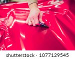 car wrapping specialist putting ... | Shutterstock . vector #1077129545
