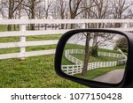 equine fences along hillside in ... | Shutterstock . vector #1077150428